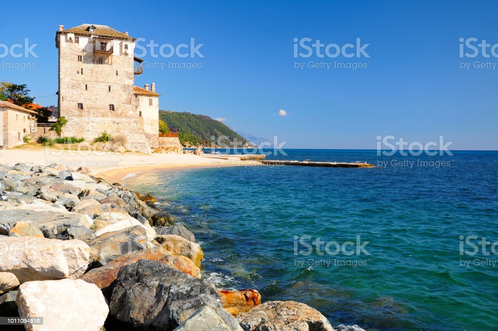 Old Byzantine tower at the beach of Ouranoupoli stock photo
