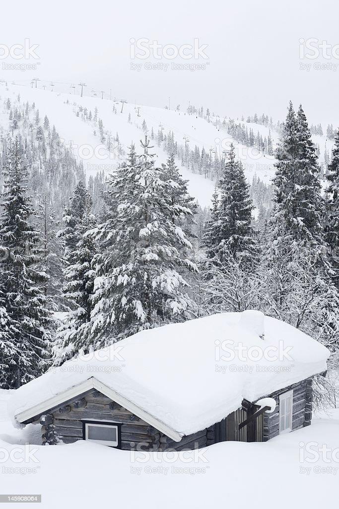 Old cabin in winter landscape stock photo