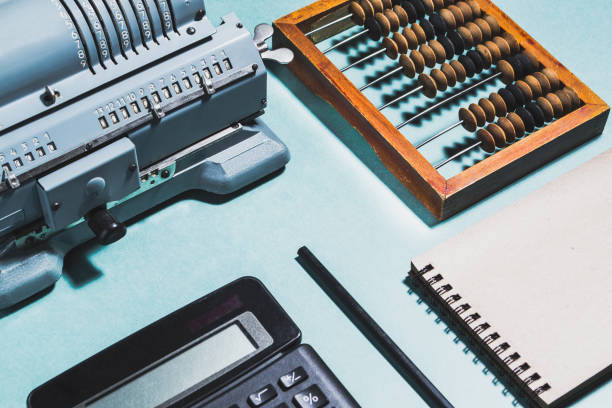 Old calculating machine on a green background. Accounting or business concept - foto stock