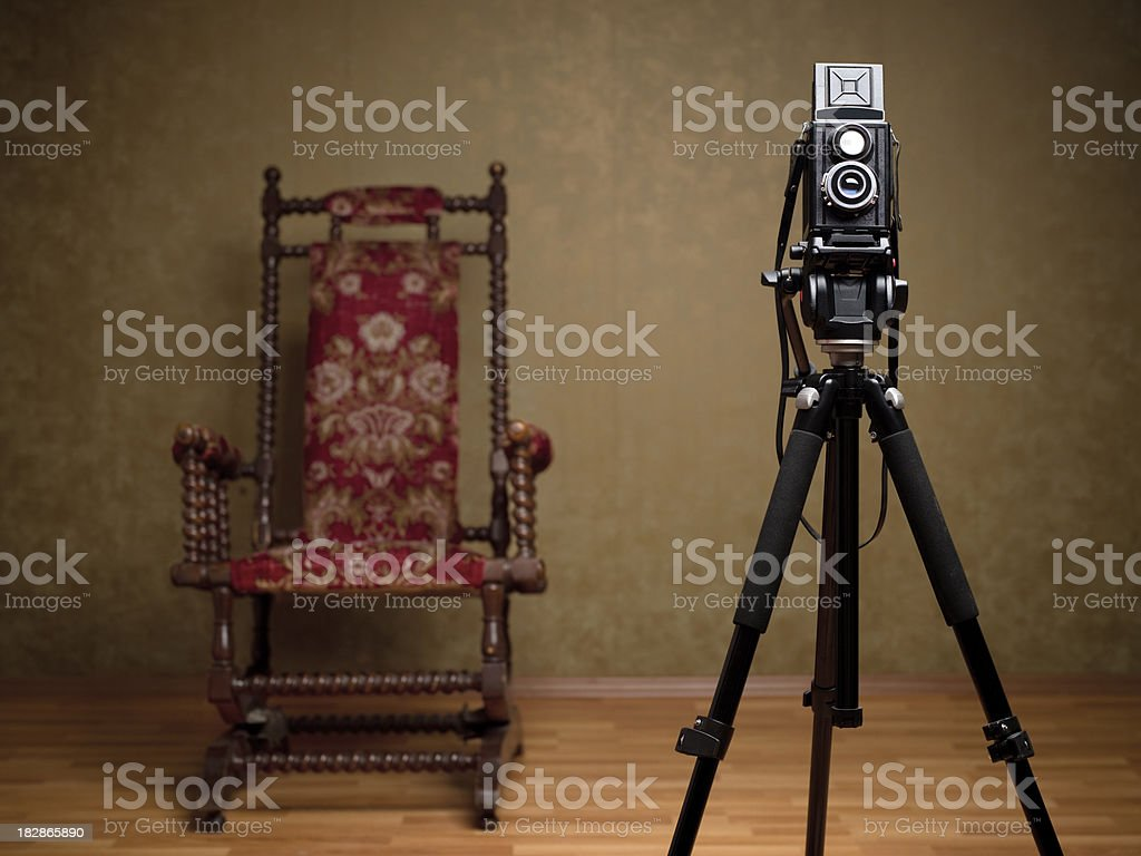 Old camera and chair stock photo