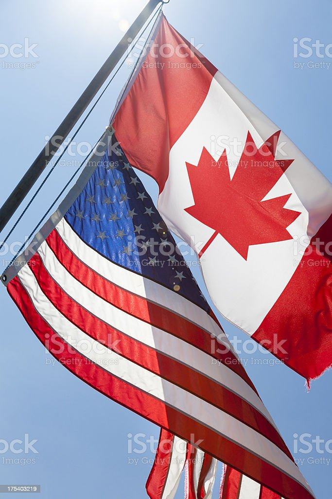 Old Canadian and American flags royalty-free stock photo