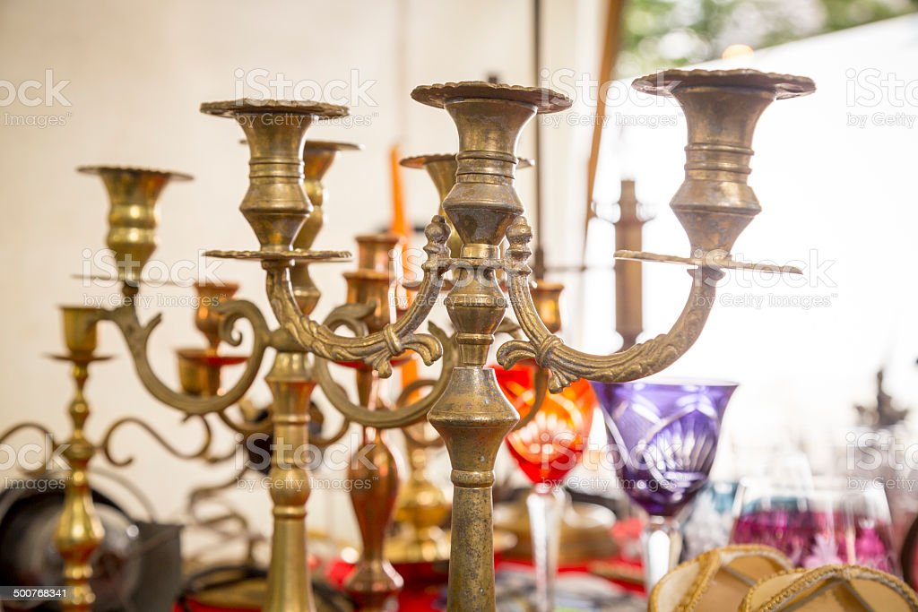 old candle stand out of brass on a flea market stock photo