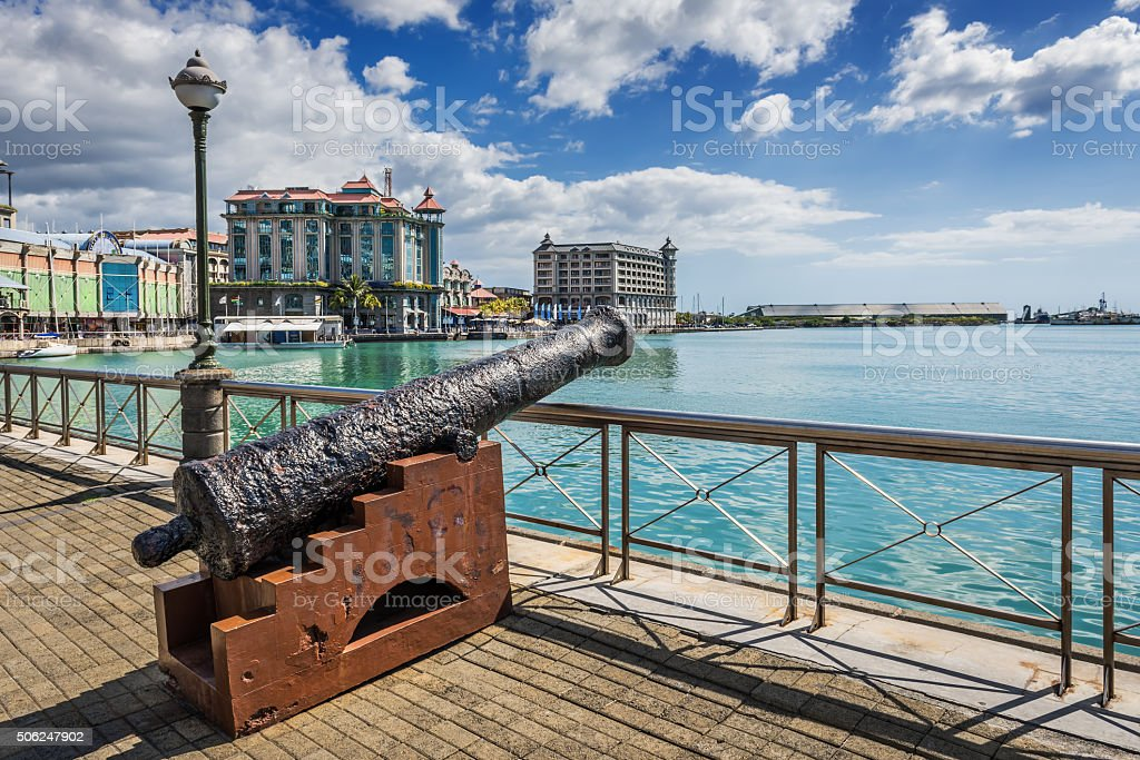 Old cannon on the promenade at Caudan Waterfront, Port Louis stock photo