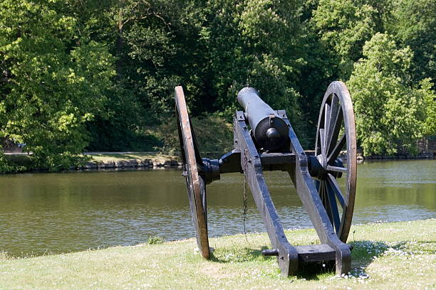 Old Cannon pointing over the Moat at Egeskov Castle, Funen stock photo