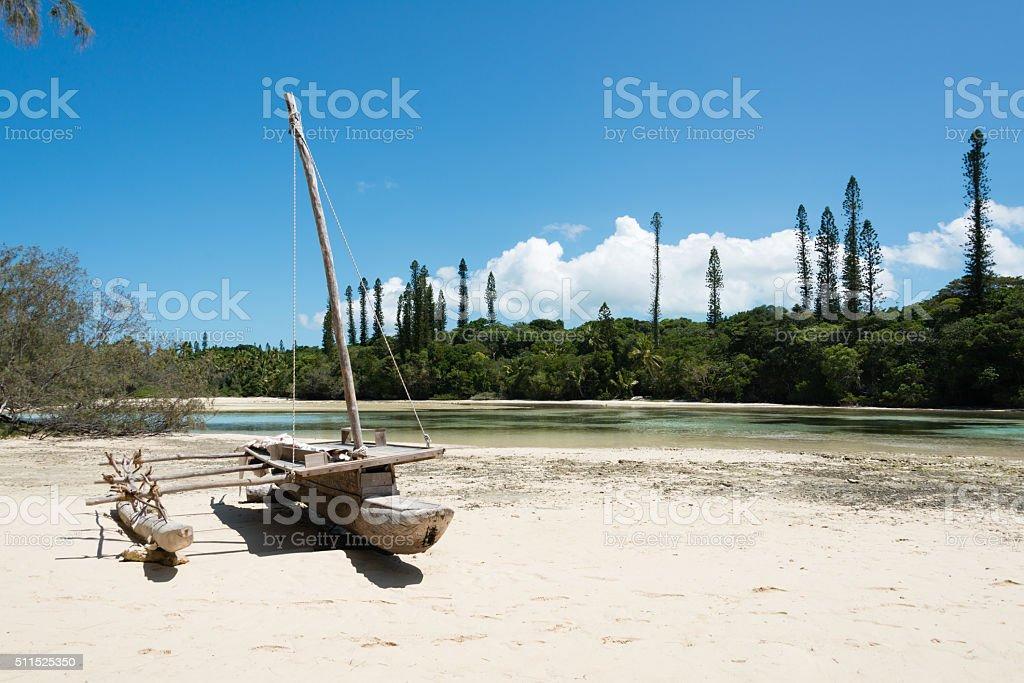Old canoe on the beach stock photo