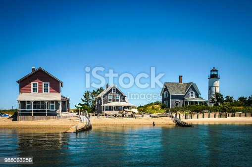 The 19th century cottage colony and lighthouse at the end of Sandy Neck peninsula in Barnstable Harbor on Cape Cod, Massachusetts has no electricity nor water.
