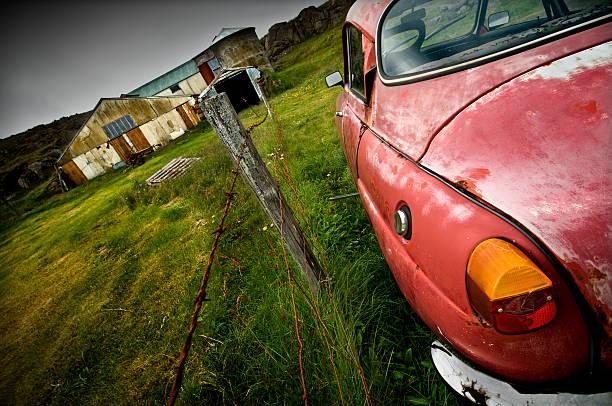 Old car and farm stock photo