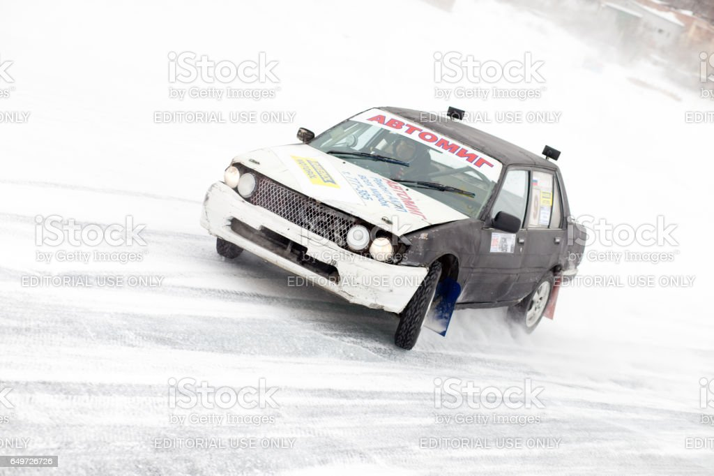 Old car at winter ice track race on frozen river stock photo