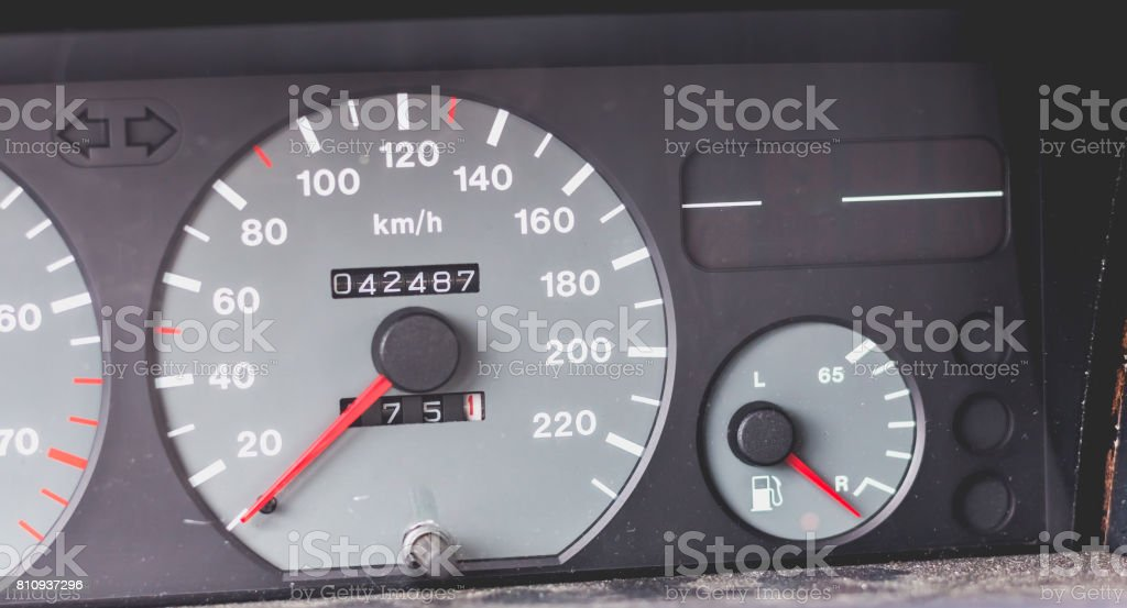 Old car dashboard of the 90's with speedometer, tachometer... stock photo
