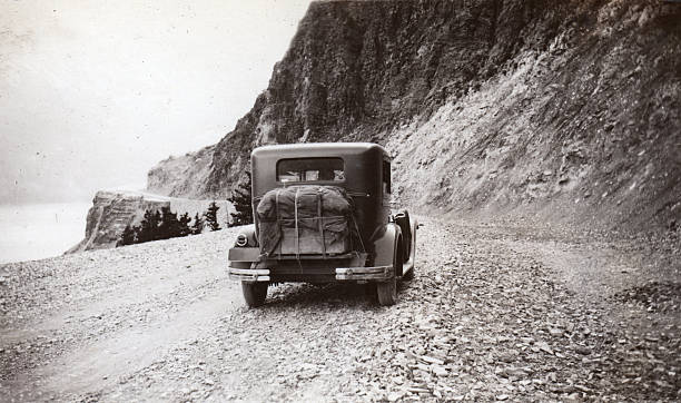 old car driving to logan pass, glacier park - logan pass stock pictures, royalty-free photos & images