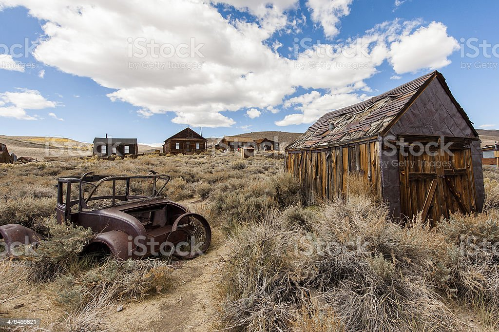 Old car in the abandoned town with blue sky stock photo