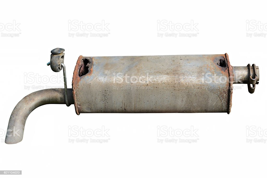 Old car muffler. Front and corrosion damage. stock photo