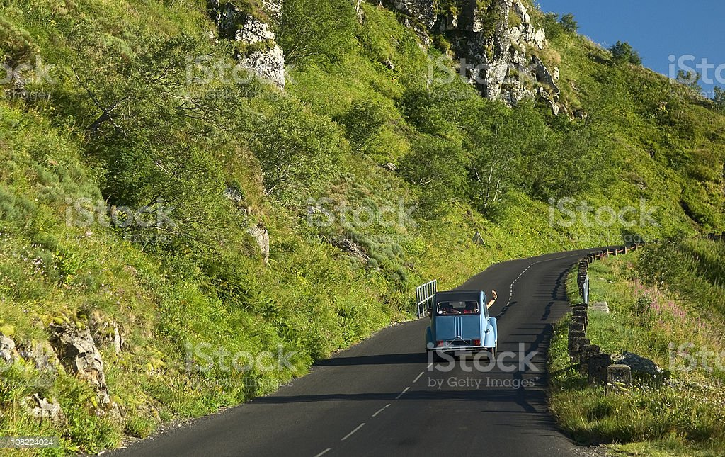 Old car on a mountain road stock photo