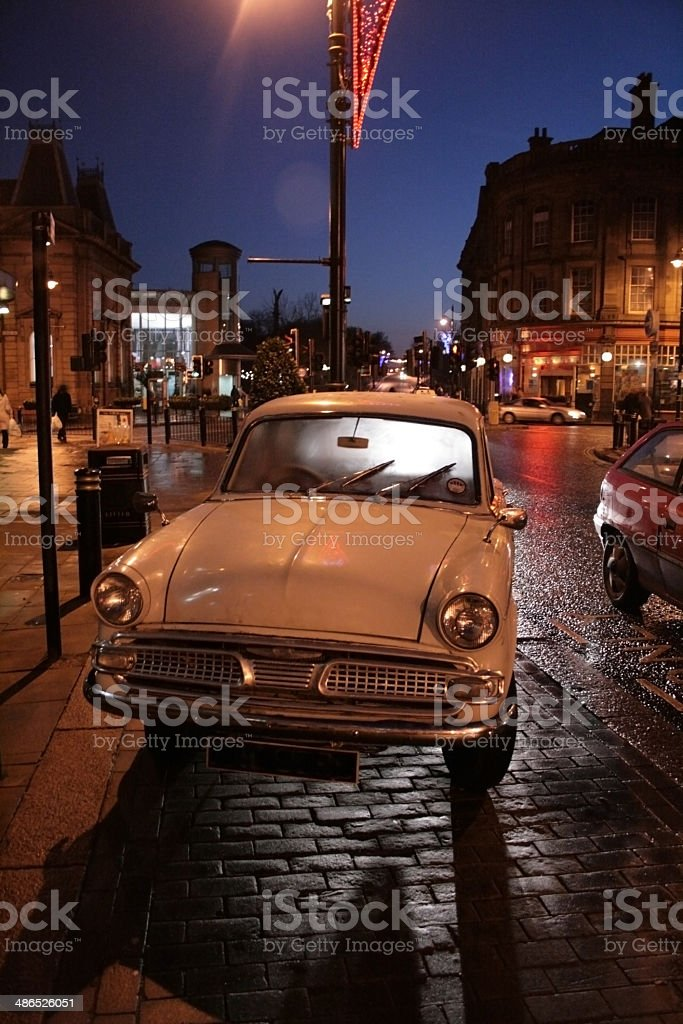 Old car on a wet night royalty-free stock photo
