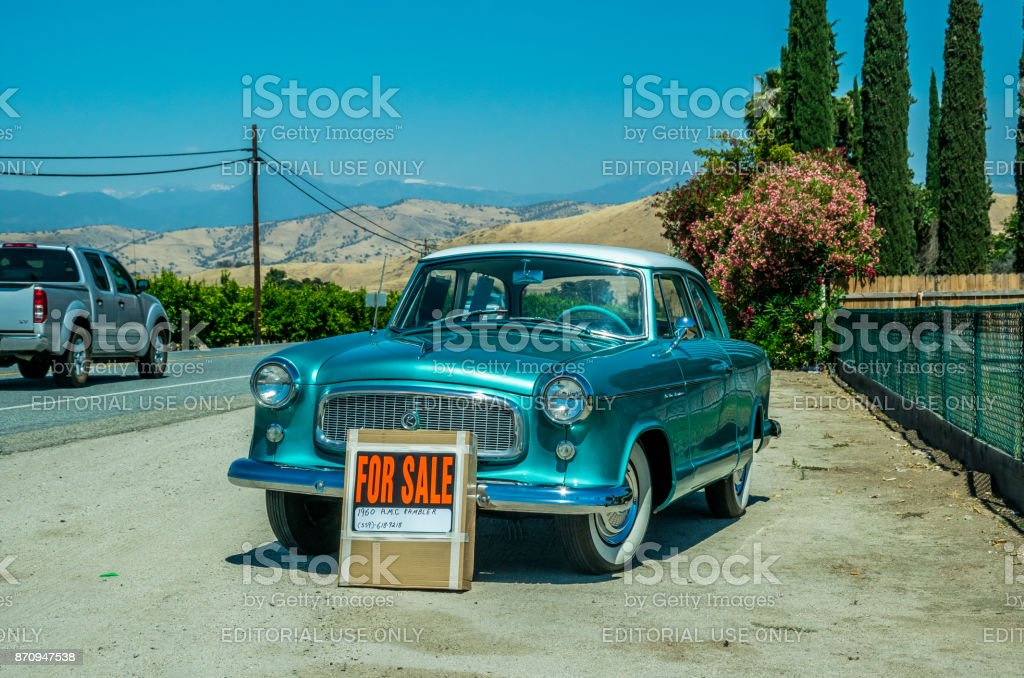 Old Car On The Roadside Sale Of Used Cars In The Usa Stock Photo
