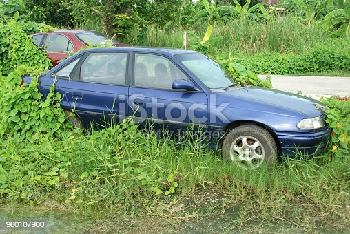 istock Old car parked for long time. 960107900