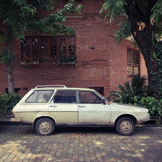 old car parked in the street - kombi stock-fotos und bilder
