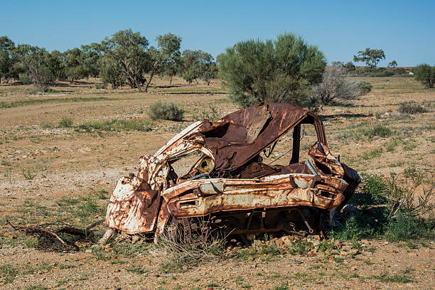 old car wreck in the middle of the outback of australia - desolated stock pictures, royalty-free photos & images