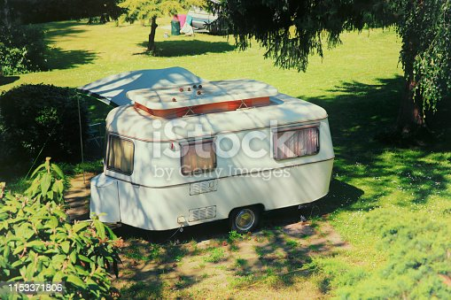 Historic 60s caravan in a campsite in Germany