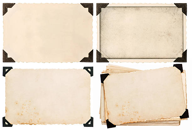 old cardboard with corner, postcard, aged paper - photo corner stock photos and pictures
