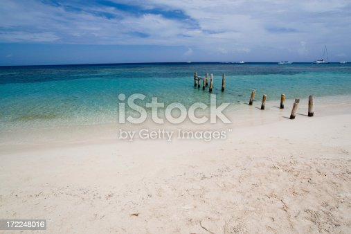 Remains of old dock on Caribbean beach