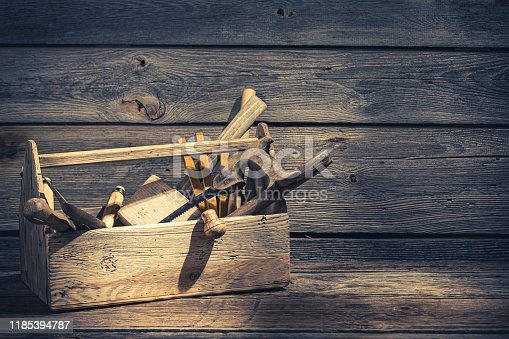 Old carpenters tool box in rustic wooden shed