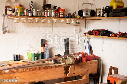 Wooden workbench lots of different tools and equipment of a carpenter at workshop.