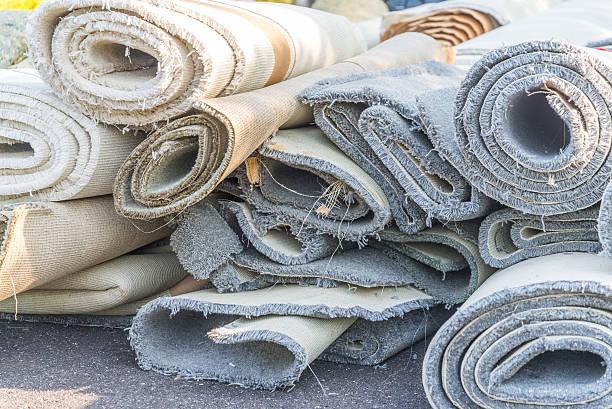 old carpet rolls stock photo