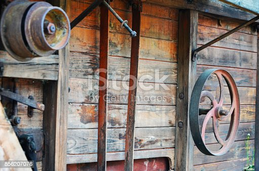 country side view - old carriage & wheels