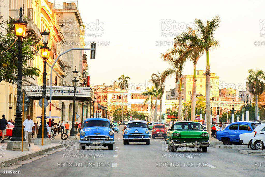 Old cars in Havana street stock photo