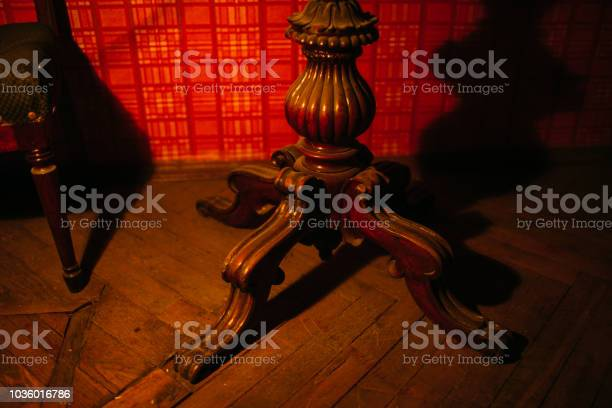 Photo of old carved leg at the table
