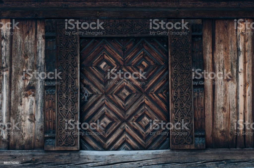 Old carved traditional Norwegian door stock photo