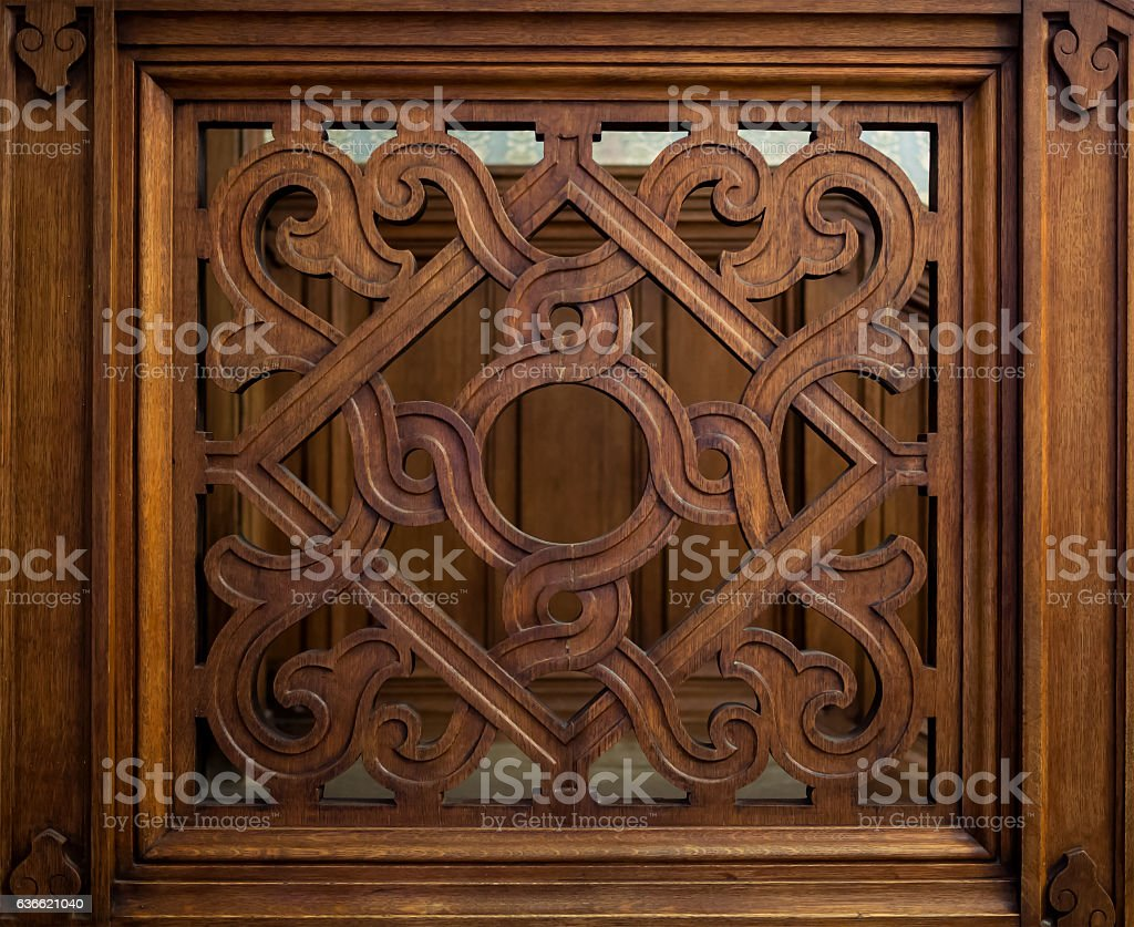 Old carved wooden lattice with a geometrical pattern stock photo