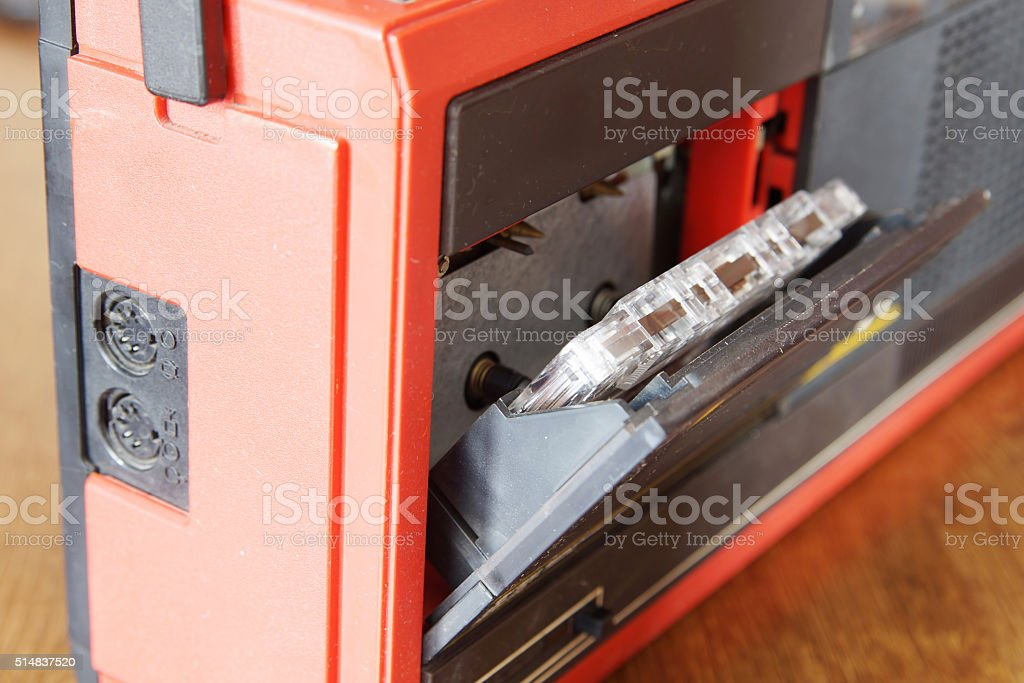 Old cassette into the record player stock photo