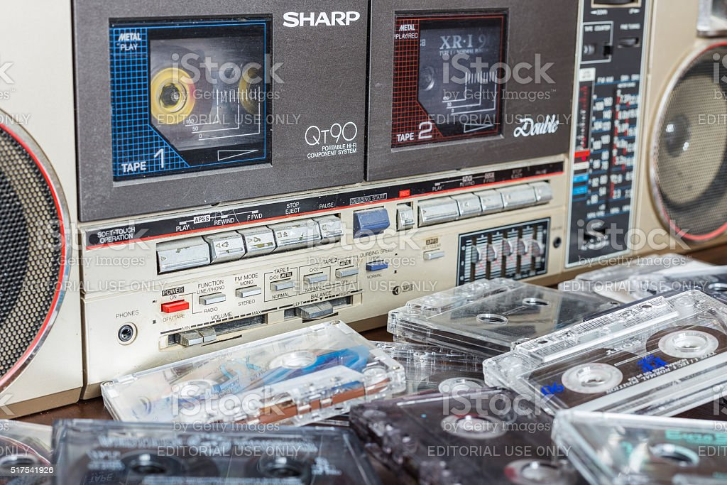 Old cassette tape recorder Sharp with cassettes. stock photo