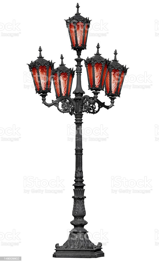 Old cast iron lamp post with red glass stock photo