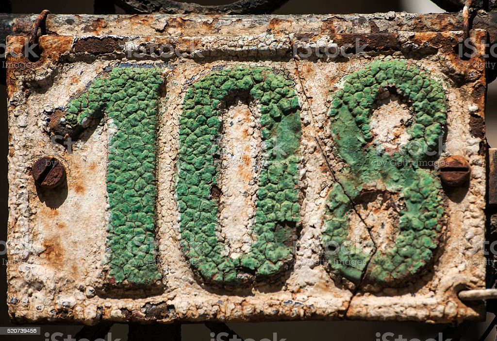 Old cast iron plate number 108 stock photo