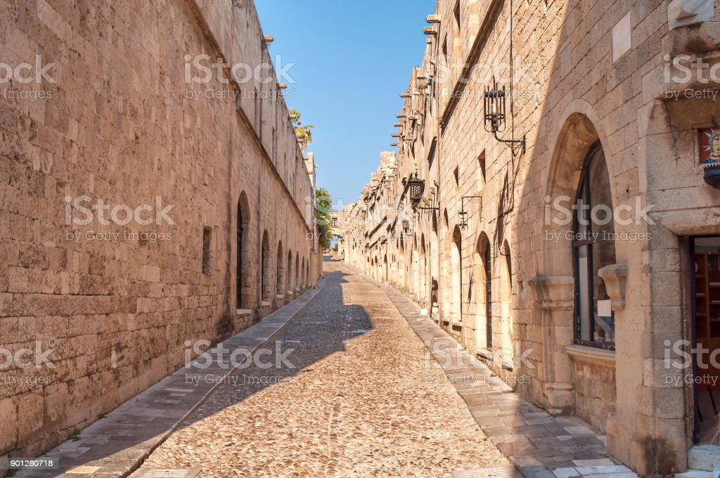 Old castle architecture building street with big wall in Rhodes Greek town stock photo