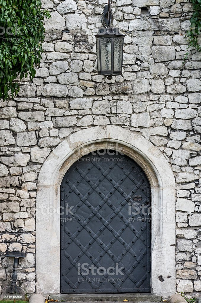 Old castle door with lantern stock photo