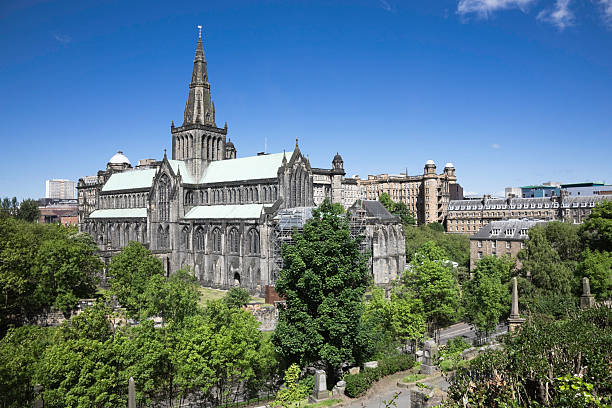 Old cathedral surrounded by trees at Glasgow St Mungo's Cathedral, Glasgow.  Viewed from the Necropolis.  There has been a church on this site for over 1500 years; the current building dates back to between the 12th and 15th centuries. theasis stock pictures, royalty-free photos & images