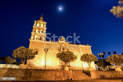 200 year old catholic church in Alamos, Sonora Mexico at night with moon above
