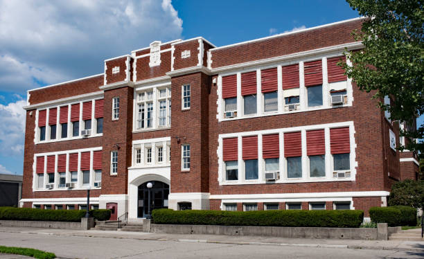 Old Catholic School Building Stately, old, red brick school building built in the 1930`s. school exteriors stock pictures, royalty-free photos & images