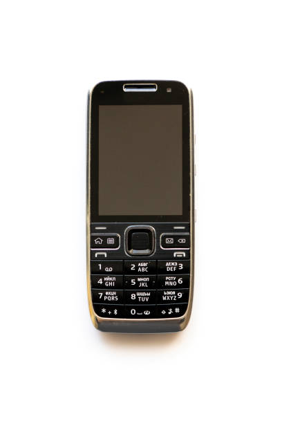 Old cell phone on the white background stock photo