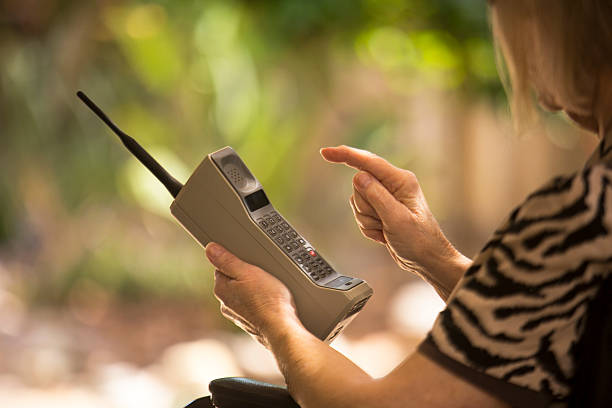 Old cell phone vintage brick stock photo