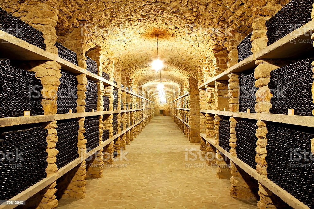 Old cellar of the winery Bottles wine in the future stock photo