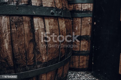 Vintage brown barrel background, closeup of old barrel