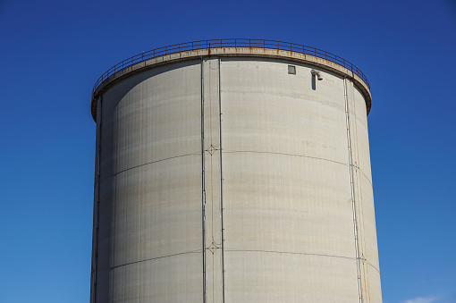 old cement silos and blue sky background .