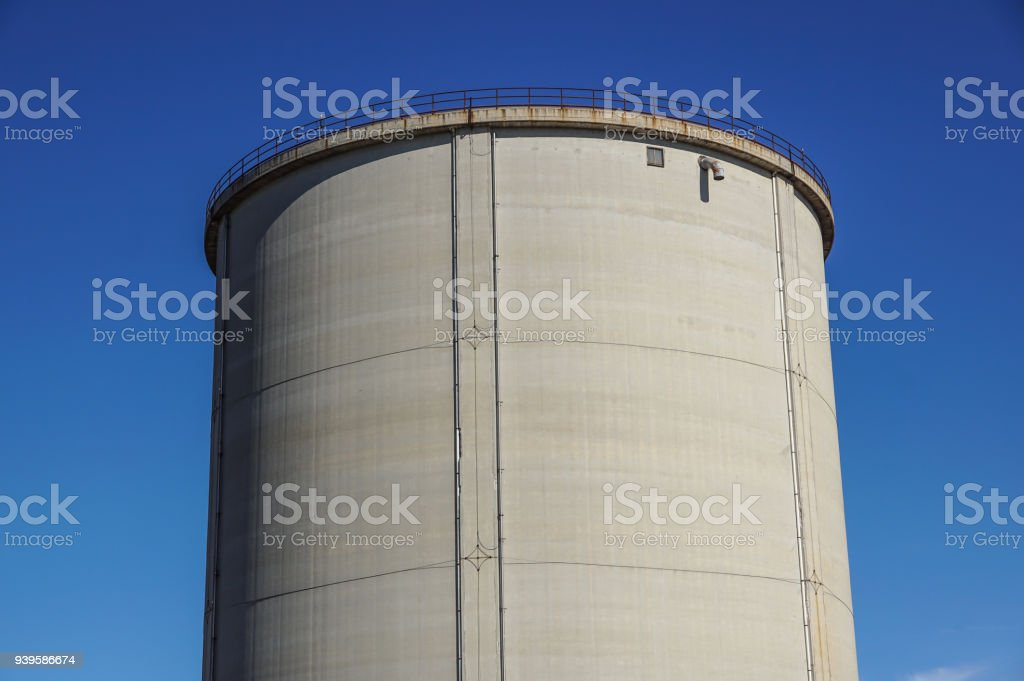 old cement silos and blue sky background - foto stock