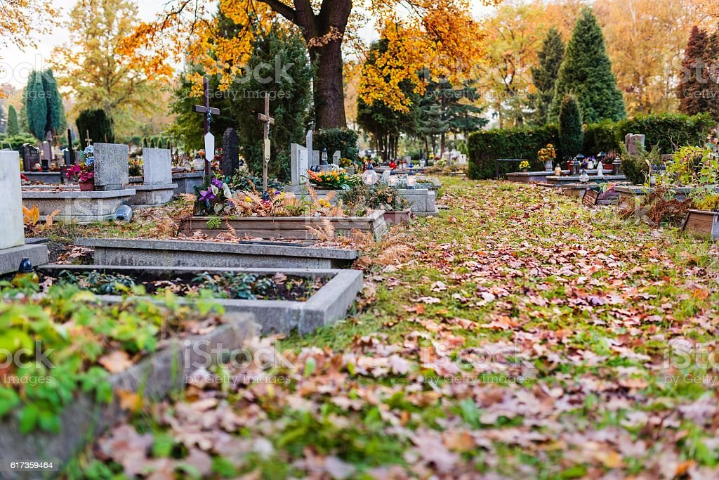 Old cemetery at autumn. stock photo