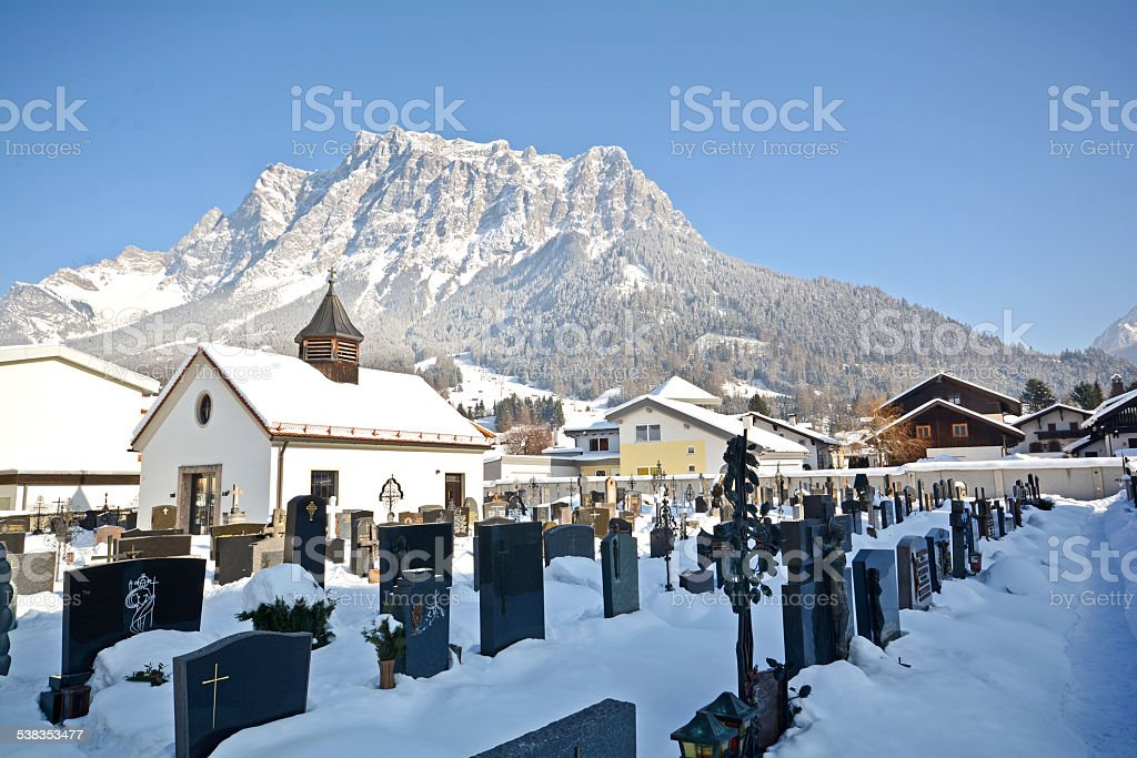 Old cemetery in Ehrwald with Zugspitze summit, Germany's highest mountain stock photo
